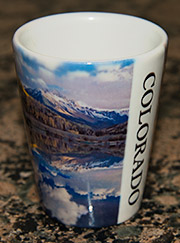 Shot glass with photos of the Rocky Mountains.